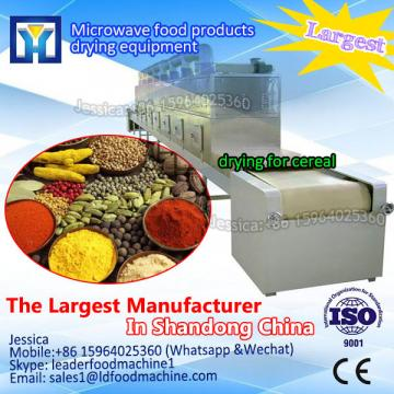 Continuous vacuum microwave drying machine